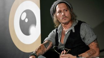 Johnny Depp spotted with a Corum Bubble People and interviews