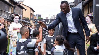 Usain Bolt strikes Kyoto charity event with kids